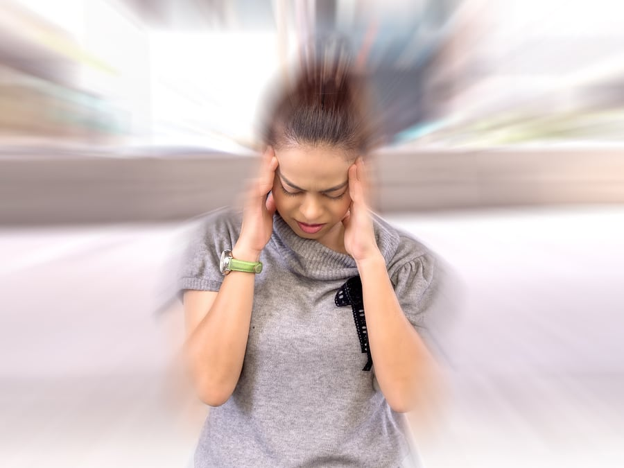 Woman with severe headache and blurry vision