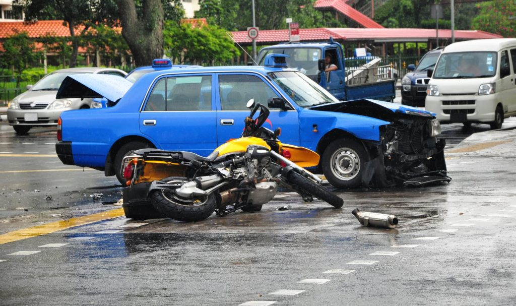 Accident scene after motorcycle and car collided