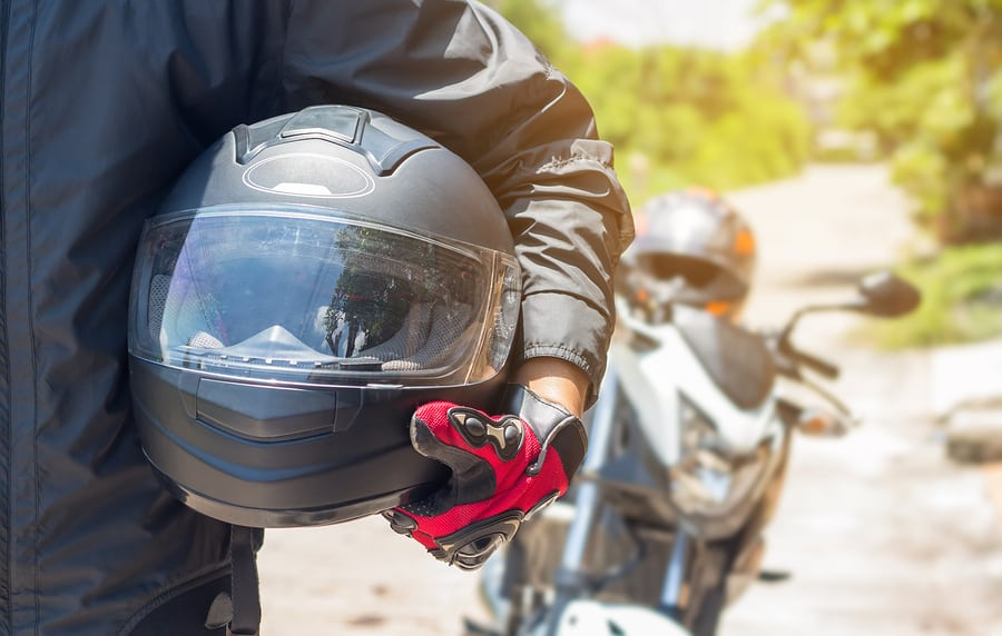 Man In A Motorcycle With Helmet And Gloves Is An Important Prote