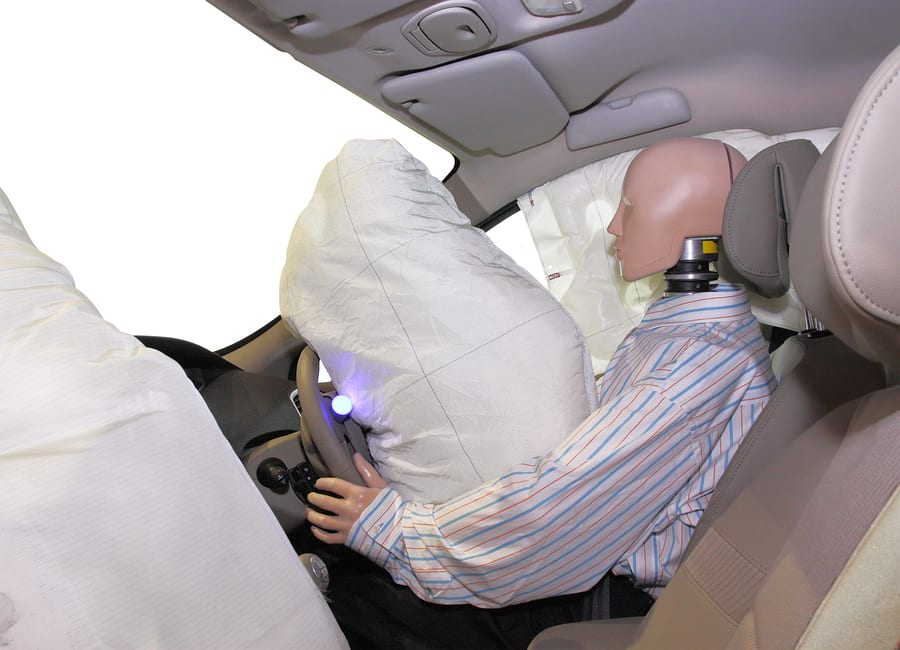 Crash test dummy in vehicle after impact