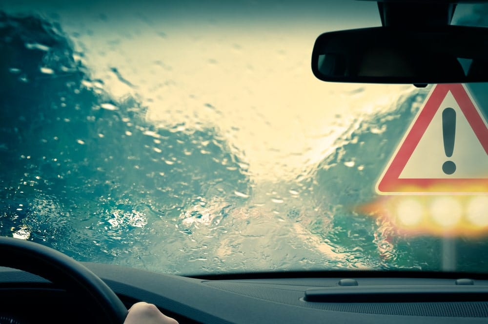 View from inside a car driving in bad weather