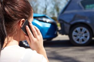 Woman On A Cell Phone After A Car Accident