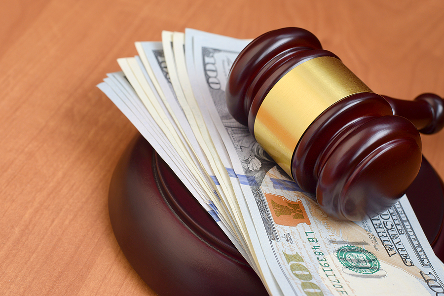 Judge Gavel And Money On Brown Wooden Table. Many Hundred Dollar